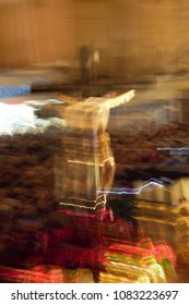 image of Jesus Christ crucified, unretouched photo,   Impressionist artistic photograph of the Holy Week in Toledo, 218. Spain, with controlled movements of the camera to suggest emotions and fervor.