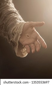 Image of Jesus Christs hand reaching out.