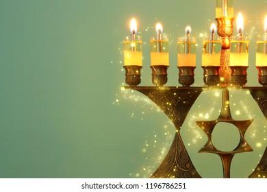 Image of jewish holiday Hanukkah background with menorah (traditional candelabra) and burning candles