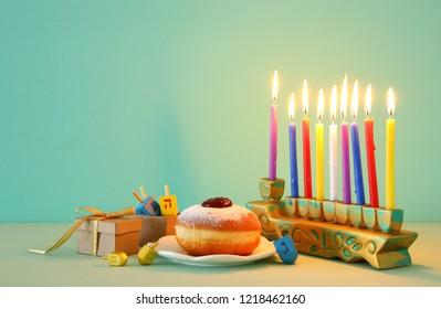 image of jewish holiday Hanukkah background with menorah (traditional candelabra)