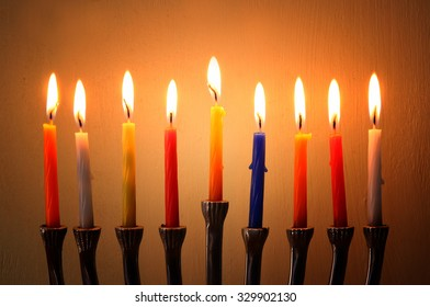 Image of jewish holiday Hanukkah background with menorah (traditional candelabra) Burning candles