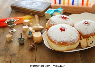 image of jewish holiday Hanukkah background with traditional spinnig top and doughnuts