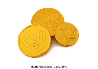 Image of jewish holiday Hanukkah with gold chocolate coins isolated on white.
