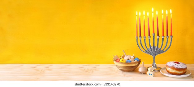 Image of jewish holiday Hanukkah with menorah (traditional Candelabra)