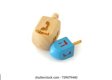 Image of jewish holiday Hanukkah symbol: wooden dreidel (spinning top) isolated on white.