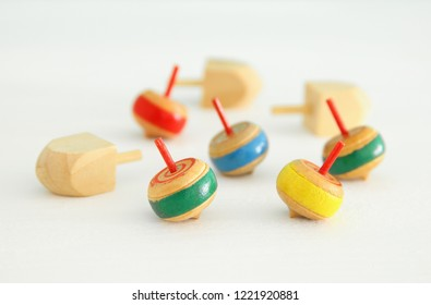 Image of jewish holiday Hanukkah with wooden dreidels colection (spinning top) over white background