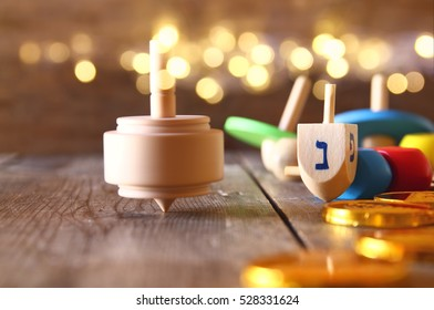 Image of jewish holiday Hanukkah with wooden dreidels (spinning top)
