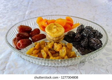 Image for the Jewish holiday Tu Bishvat, Israel. Dried fruits in a glass tray: Raisins, Prunes, Dates, Apricots, Figs