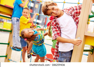 Image of joyful friends having fun on playground outdoors