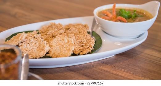"""image of """"Kao Tung Na Tang"""" Crispy rice cake and peanut pork sauce."""