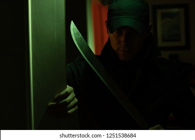Image of killer with in dark apartment with green light