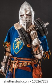 Image of knight in blue armor with a huge dumbbell