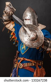 Image of knight who is demonstrating his shield and sword