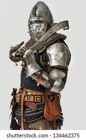 Image of knight who is posing from left side