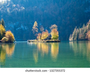 Image of lake koenigssee in berchtesgarden germany during autumn with beautiful colorful trees and island
