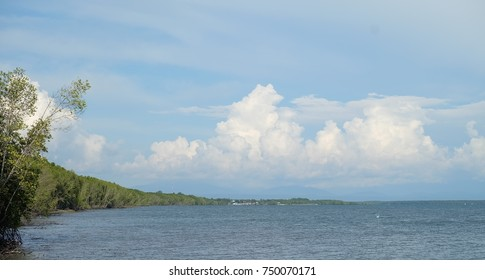 image of landscape blue sky  cloudy   with boat and jetty and sea.That place for vacation  in Trat province , eastern Thailand. concept nature background   vacation  holiday  tourism.