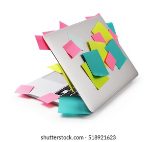 Image of laptop full of colorful sticky notes reminders isolated on white. Work overload concept image