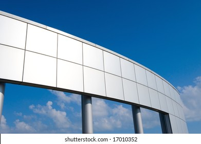 An image of a large metal structure on a bright blue sky