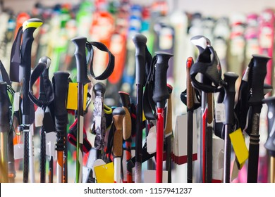 Image of large selection of ski poles in store.