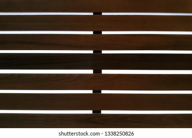 Image of a lattice of wooden slats of dark brown color for use as a background.