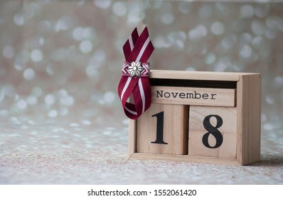 image of Latvian flag symbols on the calendar in honor of the declaration of independence of Latvia on November 18