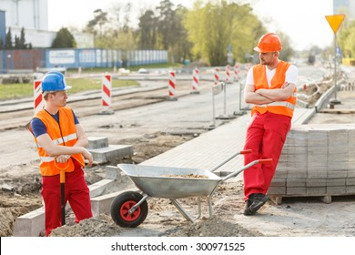 Image of lazy construction workers having break