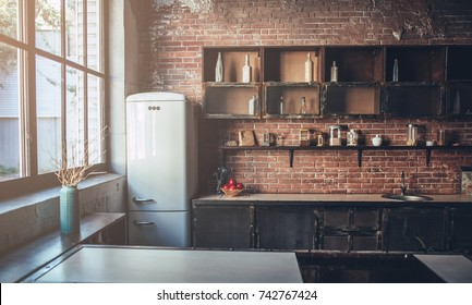Image of light wooden kitchen in the morning.