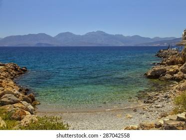 Image of a lite cove beach in Agios Nikolaos. Crete, Greece.
