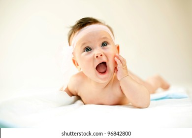 An image of a little baby-girl with her mouth open