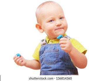 Image of little boy with some plasticine in his hands isolated on white