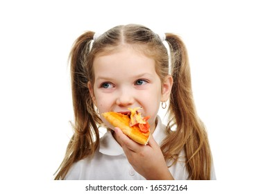 Image of a little girl eating pizza close-up