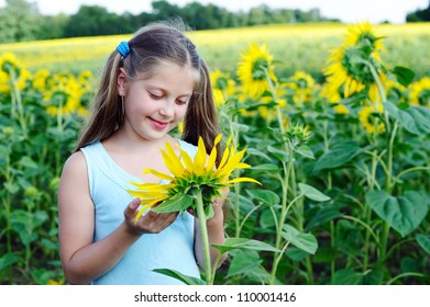 An image of a little girl with sunflower