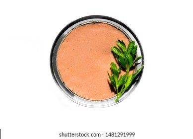 image with liver pate. Liver pate in the box. A green parsley leaf. Subject isolated on white background