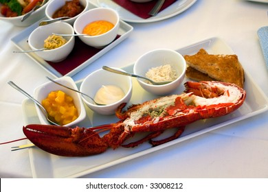 Image of lobsters ,fresh roasted on a grill,with sauce bechamel