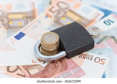 An image of a lock and money: keeping your savings secure