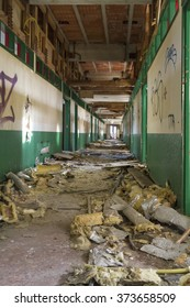 An image of a long devastated corridor
