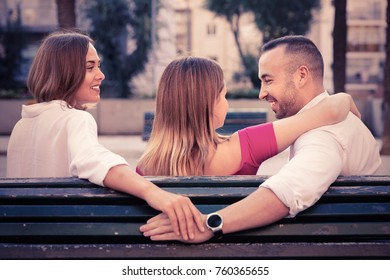 Image of the love triangle between cheerful positive people outdoor