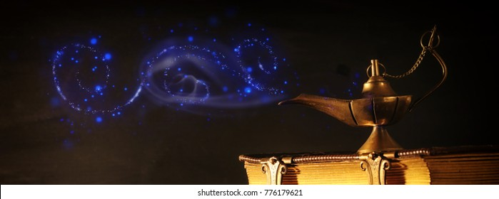 Image of magical aladdin lamp and old books. Lamp of wishes