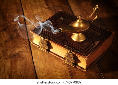 Image of magical aladdin lamp with smoke. Lamp of wishes
