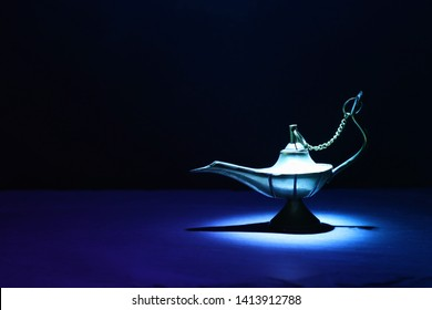 Image of magical mysterious aladdin lamp. Dark background and dramatic light