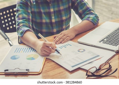 Image of male hand with business document