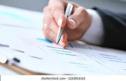 Image of male hand pointing at business document during discussion at meeting close-up.