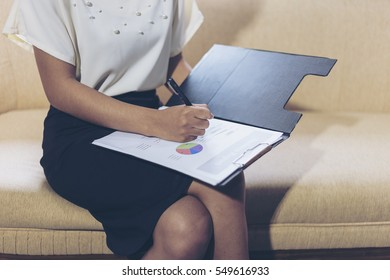 Image of male hand pointing at business document during business discussion