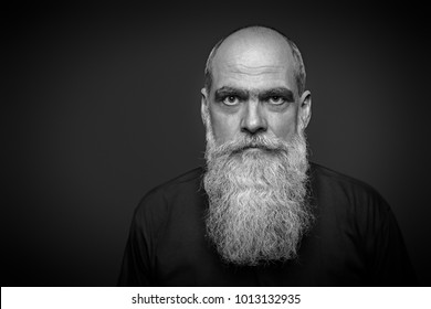 An image of a male portrait with long beard