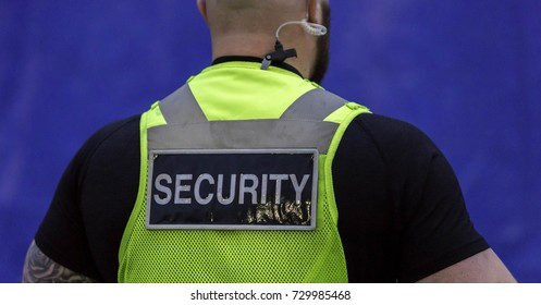 Image of male security Guard with bright top on.