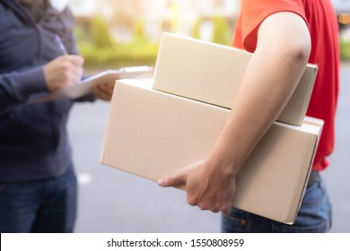 image of man accepting a delivery of boxes from deliveryman