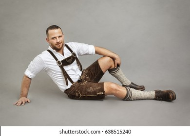 An image of a man in bavarian traditional lederhosen