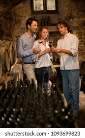 Image of Man explains wine to couple