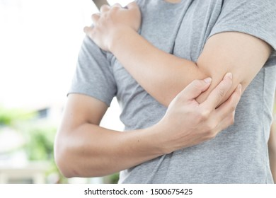 The image of the man holding the elbow