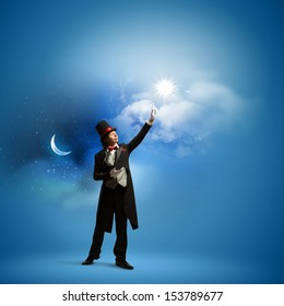 Image of man magician against color background
